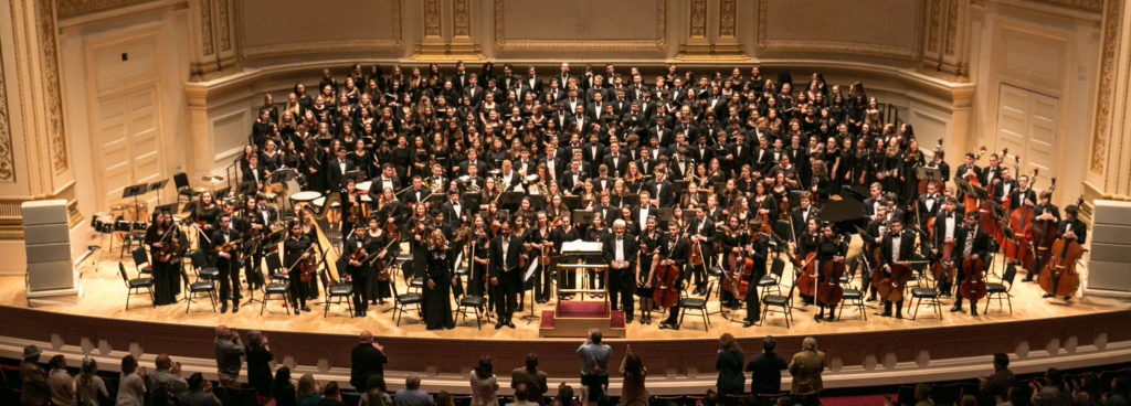The Suffolk Principal Orchestra and MYO Choirs onstage at Carnegie Hall with Music Directors Edward P. Norris, III and Phil Preddice from May 14, 2017. Photo credit: Musical Memories Photography
