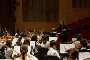 Michelina Sobolewski conducting the Nassau String Orchestra at AUPAC